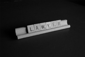 Image of the word LAWYER formed by the pieces on a scrabble board game.